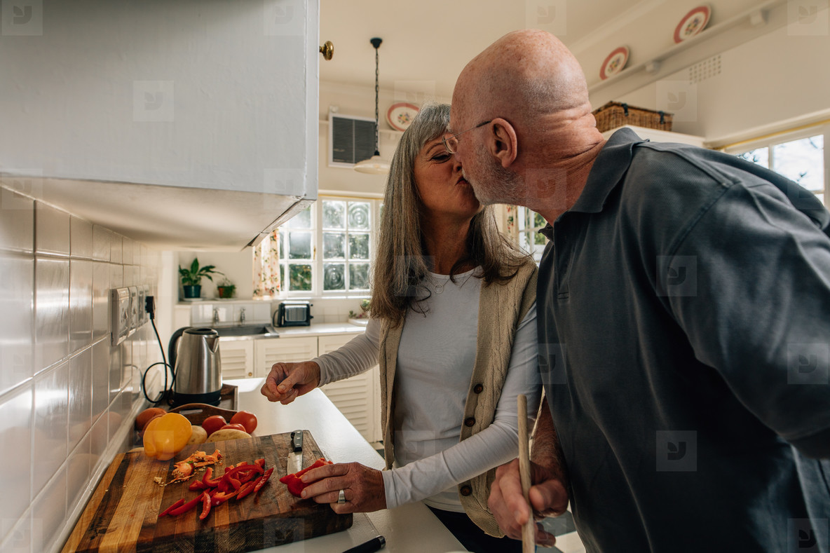 Senior couple cooking together in kitchen