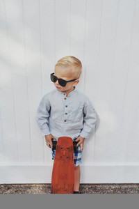 Cute little boy in a trendy summer outfit