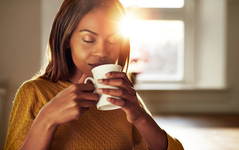 Attractive woman enjoying a cup of fresh coffee