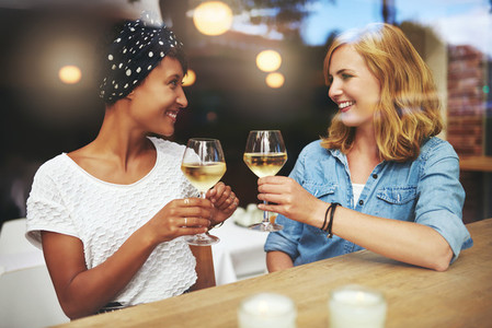 Pretty young women toasting each other
