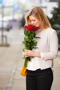 Professional white woman smiling roses