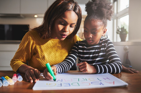 Black mother and child doing homework