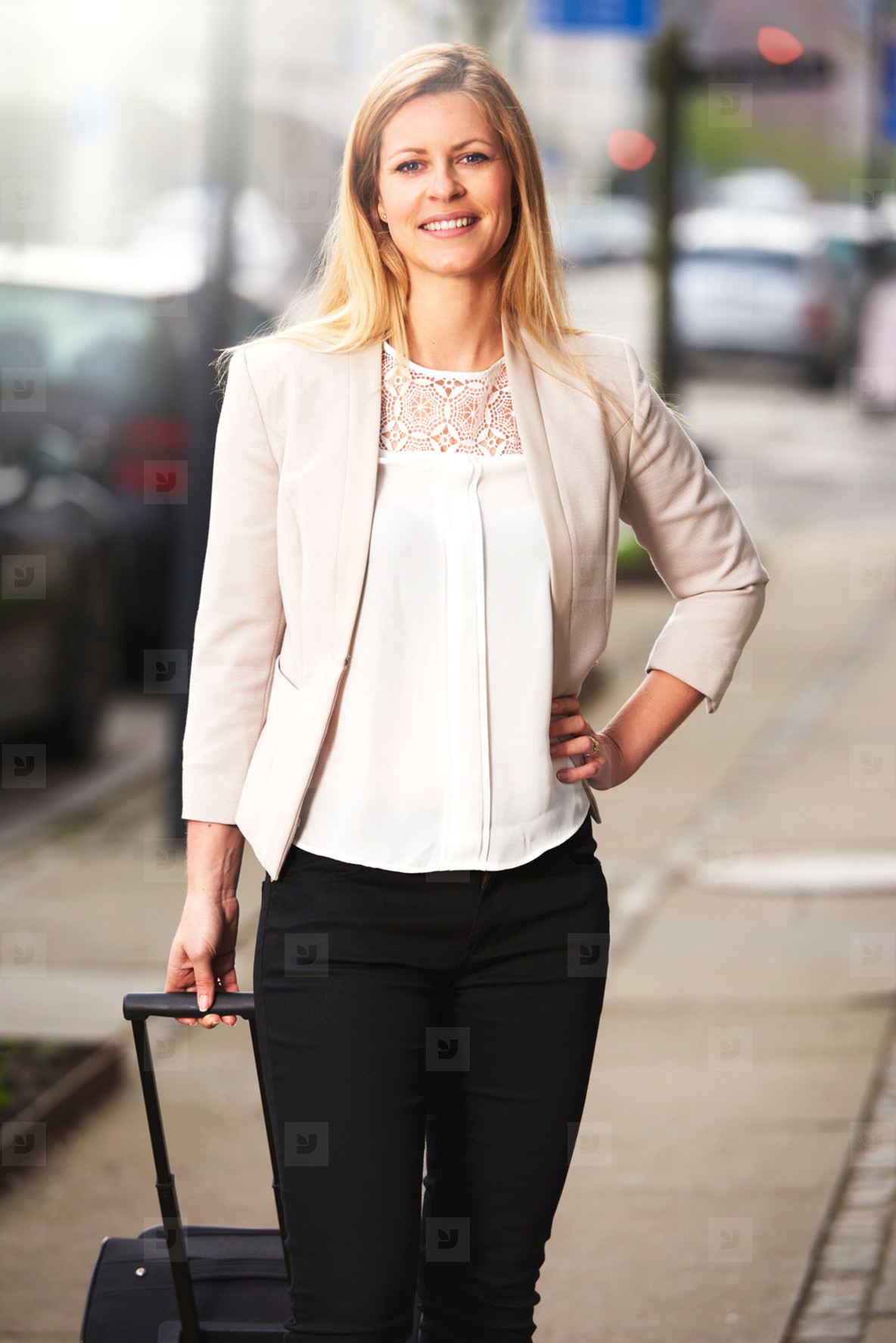 Professional woman posing for picture on sidewalk