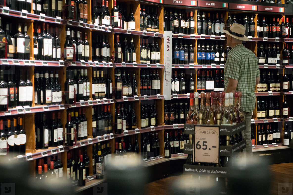 Man choosing wine in a wine stor