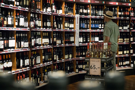 Man choosing wine in a wine stor