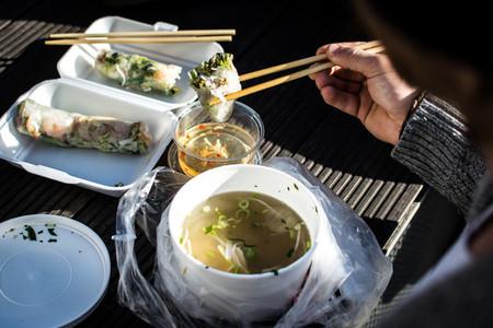 Man eating Vietnamese food