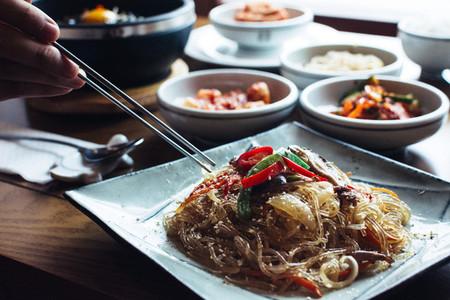Man eating Korean glass noodles
