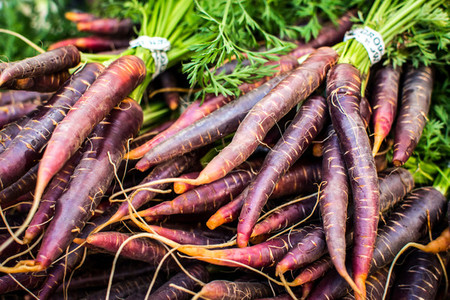 Organic purple carrots at market