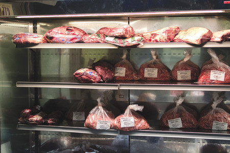 Packages of meat in cooler
