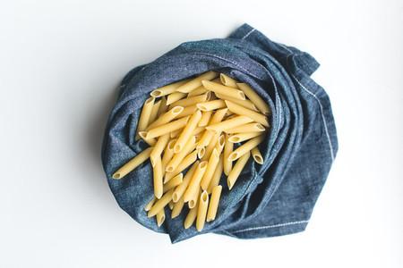 Pasta penne in a blue linen
