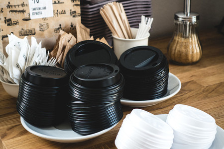 Plastic coffee cup lids