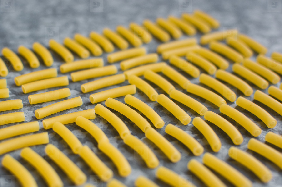 Playing with raw pasta macaroni