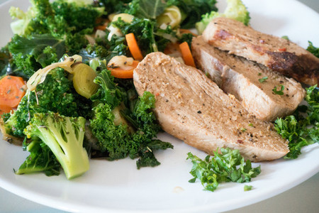Pork meat with green vegetables