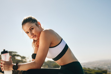 Close up of a female athlete taking a break from workout
