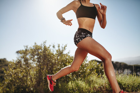 Side view of a fitness woman running