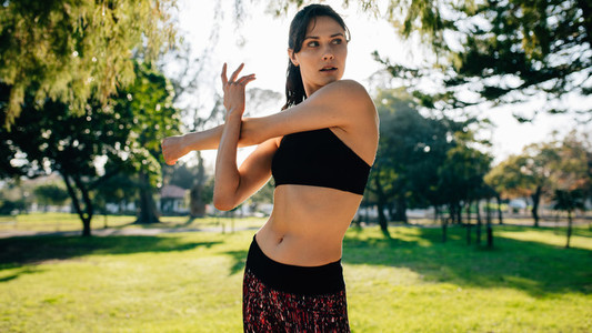 Female runner stretching hands before working out