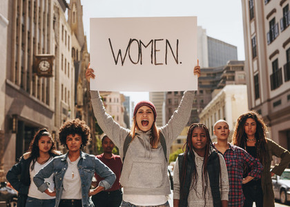 Womens march in protest on road
