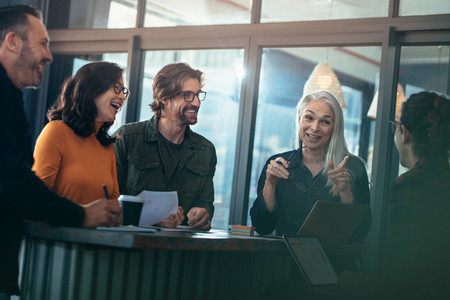 Business group having casual talk in meeting