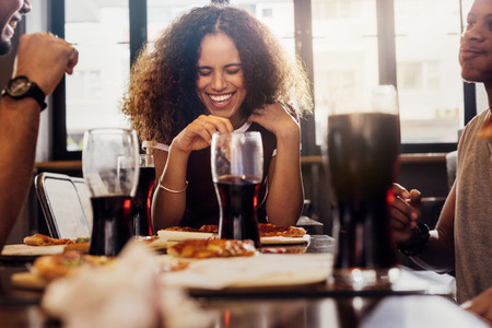 Woman enjoying lunch with friends at cafe