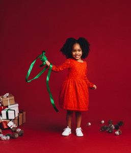 Afro american kid playing with a ribbon