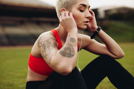 Close up of a female athlete relaxing listening to music
