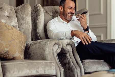 Happy businessman having a conversation over phone