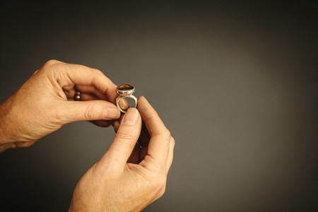 Goldsmith examining a ring