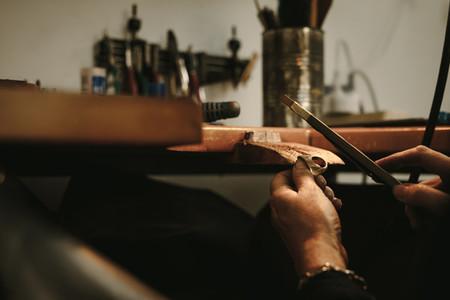 Goldsmith making gold ring at workshop