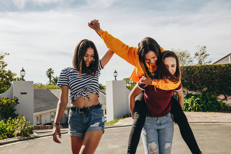 Three girl friends playing in the street