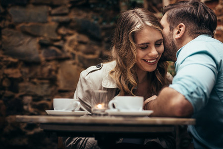 Close up of a couple sitting in a cafe