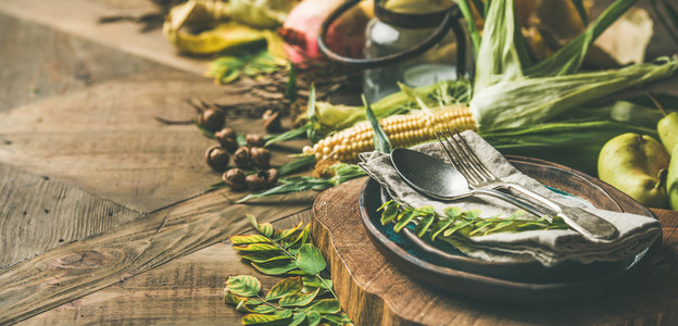 Fall table setting with seasonal food for Thanksgiving day celebration