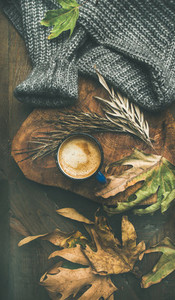 Autumn morning coffee concept with leaves and sweater  vertical composition