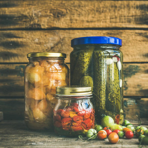 Autumn pickled vegetables in glass jars  copy space  square crop