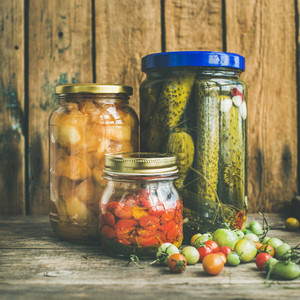 Autumn seasonal pickled vegetables and fruit in jars  square crop