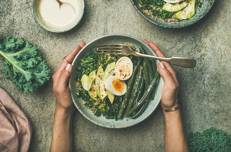 Quinoa  kale  green beans  avocado  egg bowls flat lay