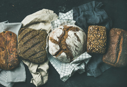 Various bread selection flat lay black background