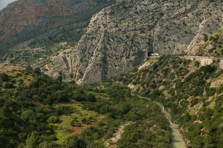 Views of a large valley in Ardales  Andalusia  surrounded by mountains and a train that goes through the mountain tunnel
