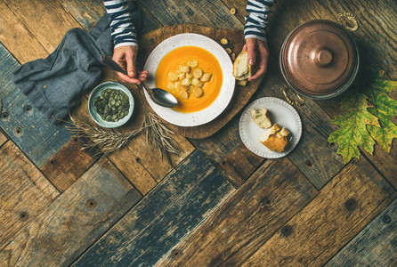 Fall warming pumpkin cream soup copy space