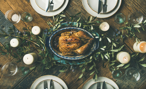 Holiday table setting for party  gathering or celebration roast chicken