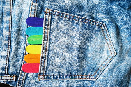 Denim poket with colorful sticks