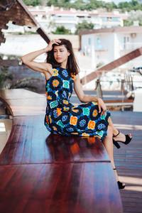 Brunette dress sitting on bench