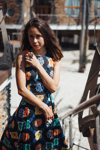 Young girl in a dress posing on a street
