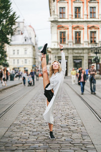 beautiful young girl lifted her leg up