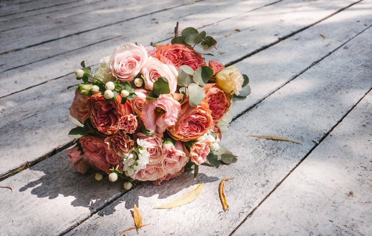 wedding bouquet on the wooden floor