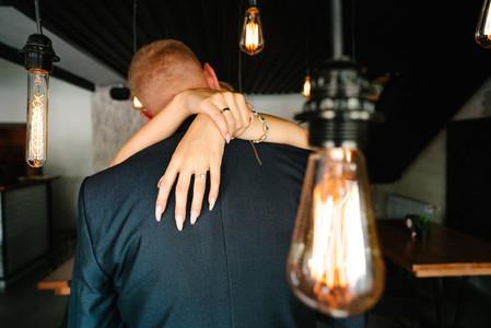 retro bulbs lights  newlyweds couple embracing