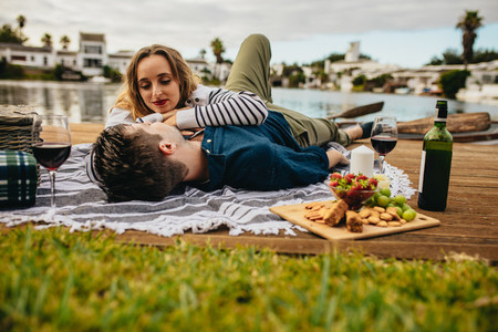 Couple enjoying their date near a lake