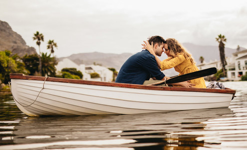 Romantic couple on a boat date in a lake
