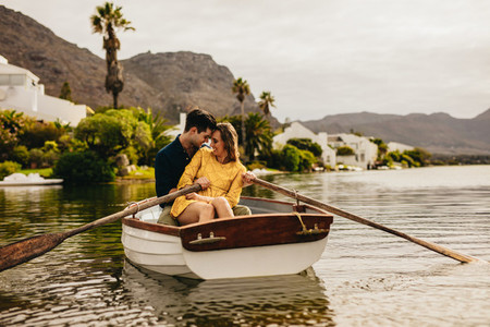 Couple enjoying their boat date in a lake