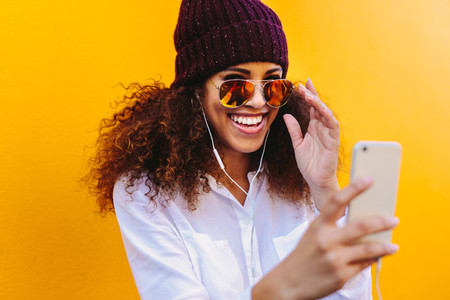 Stylish african woman doing a video chat