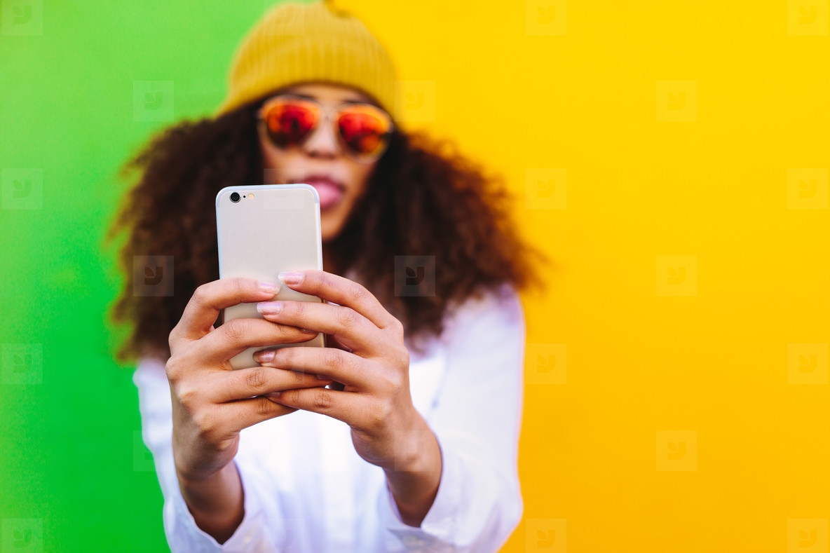 Stylish african girl taking a selfie